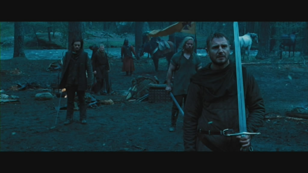 Liam Neeson as Godfrey awaits a confrontation. With a nice sword.