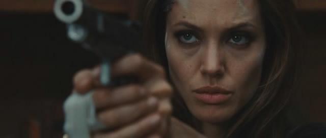 Angelina Jolie shows off her gun.