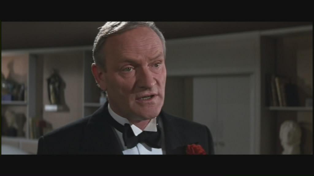 Walter Donovan explains the plot.