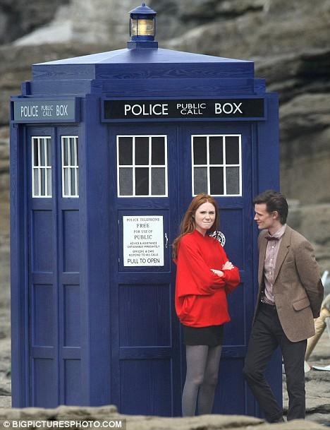 Smith & GIllan stand next to the iconic TARDIS.