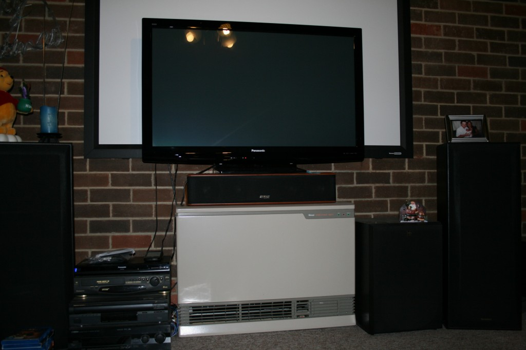 The new screen sits in front of the old projector screen... Note size difference (but not picture quality)...