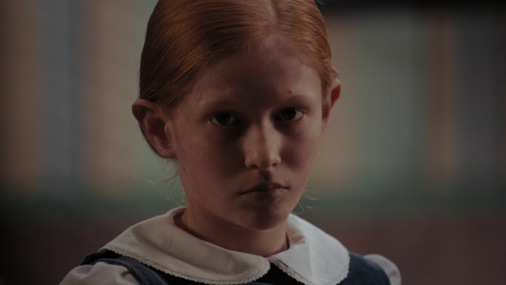 Every scary movie needs a creepy red-headed girl in it.
