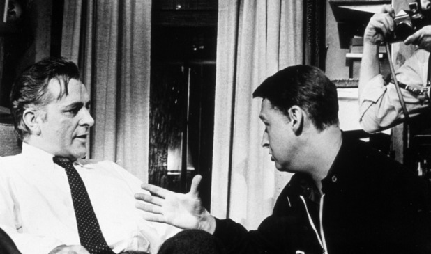 Richard Burton (L) discusses a scene with director Mike Nichols (R) on the set of Who's Afraid of Virginia Woolf?, circa 1966.