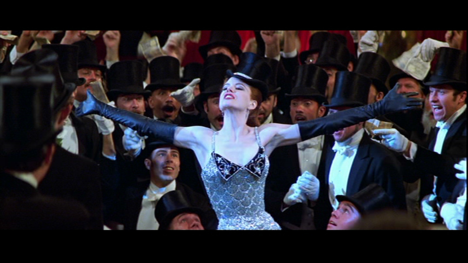 an analysis of moulin rouge This scene, taken from the film 'moulin rouge', is used in telling the story of what is happening at this point in the film between satine, a star courtesan in the moulin rouge nightclub, and the duke, who she is pretending to be in love with.
