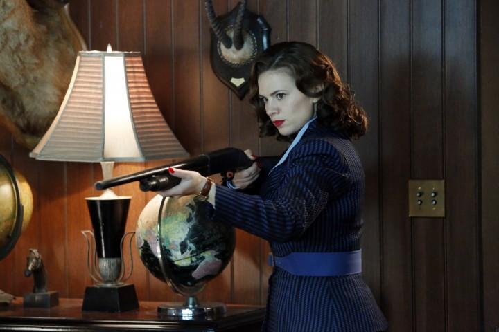 That's better. A woman holding a big gun!