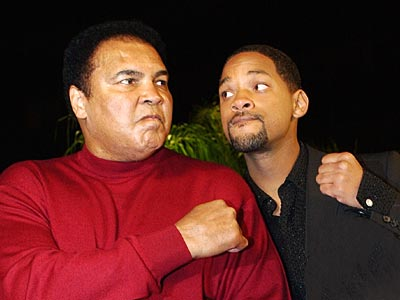 Muhammad Ali posing with Will Smith, who portrayed the boxer in the 2001 film Ali.