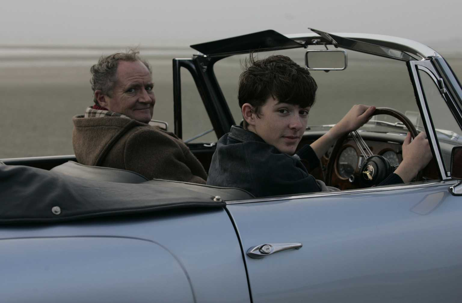 Arthur and Blake drive a car on the beach. Yes, it's quite safe, I assure you.