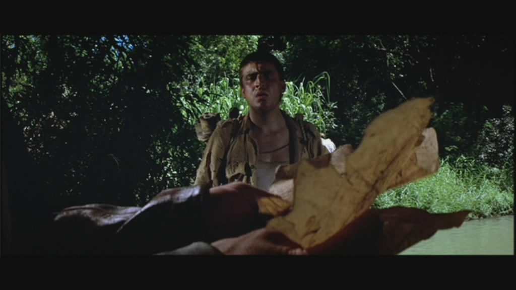 Alfred Molina watches Indy read a map.