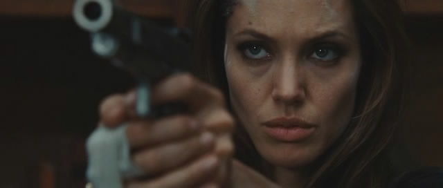 Angelina Jolie shows off her gun.