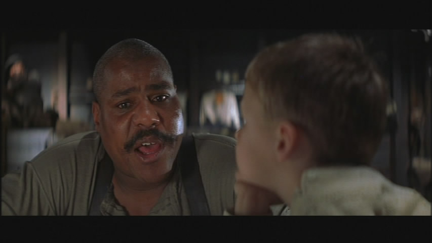 Danny (Bill Nunn) teaches words to a young 1900.