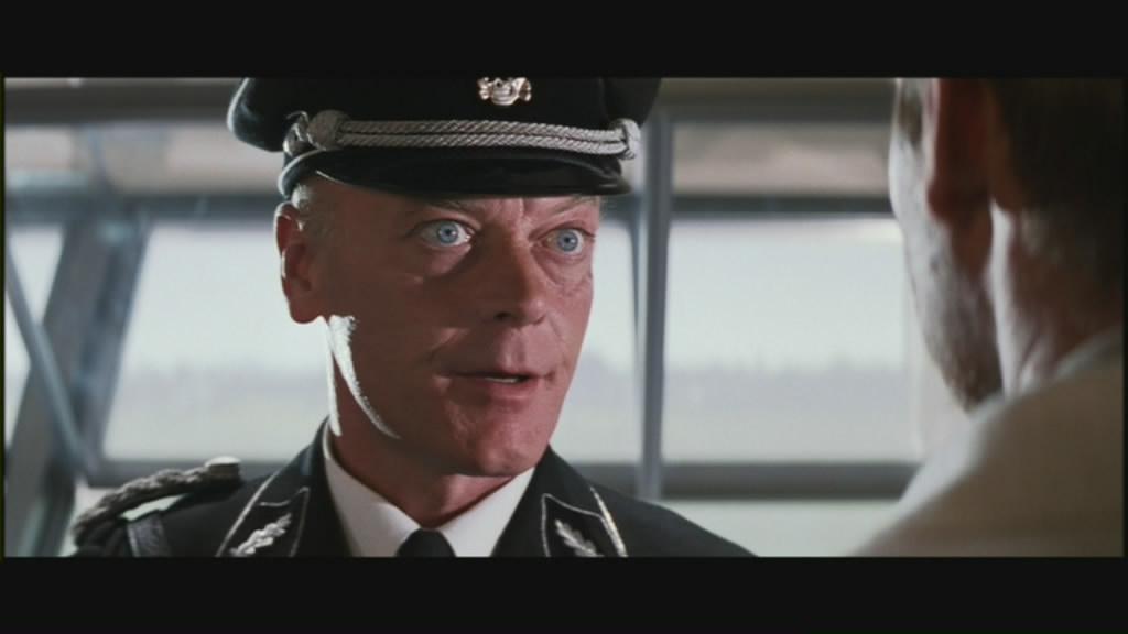 Michael Byrne as Vogel, a Nazi stooge.