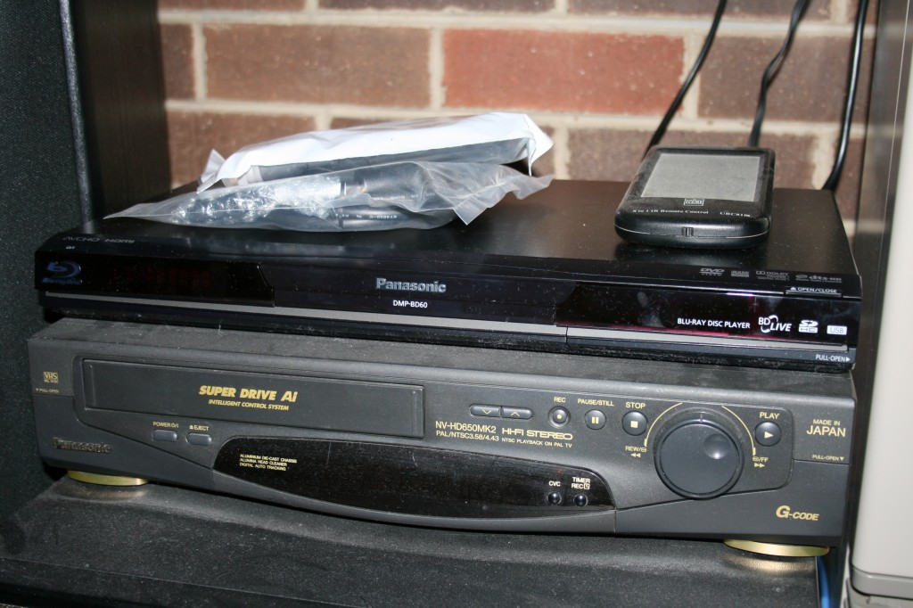 The Panasonic BluRay player takes pride of place on top of the home cinema pile....