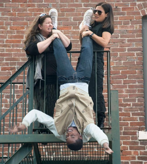 Two white women hanging a black man over a balcony? Racist? Not us!!