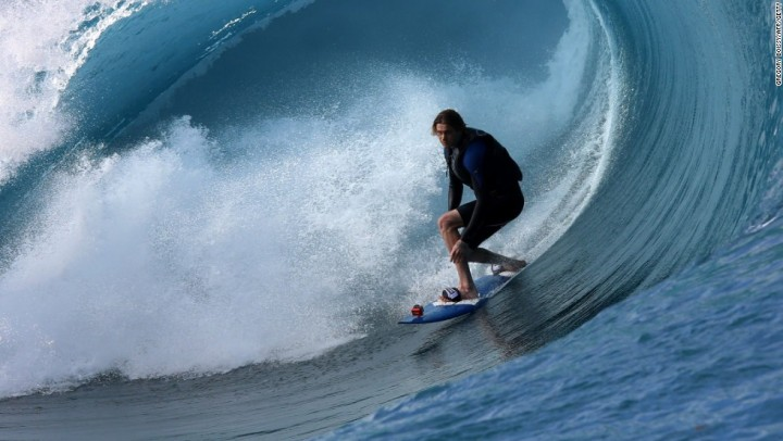 "A surfer rides a wave during the shooting of a remake of the 1991 classic ""Point Break"" on September 11, 2014 in the Hava'e pass in Teahupoo, on the French Polynesian island of Tahiti. The American action thriller film directed by Ericson Core, starring Edgar Ramirez, Luke Bracey, Teresa Palmer and Ray Winstone, is a remake of the 1991 film then directed by Kathryn Bigelow.   AFP PHOTO / GREGORY BOISSY"