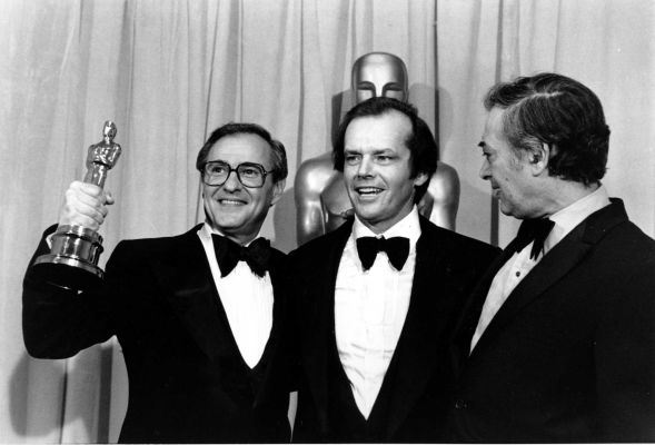 Jack Rollins (R) collecting the Oscar for Best Film for Annie Hall, with star Jack Nicholson (C) and co-producer Charles Joffe (R), in 1978.