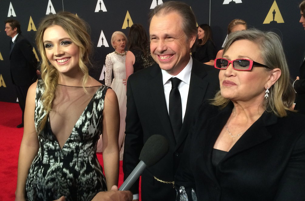 Accepting the award for Debbie Reynolds was her granddaughter Billie Lourd (L), her father and mother, Carrie Fisher (R).