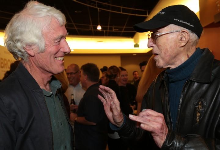 Haskell Wexler (R) chats with fellow Oscar-winning Cinematographer Roger Deakins, photograph circa December 2014.