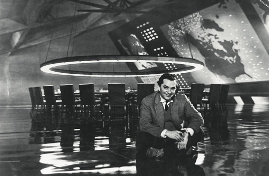Sir Ken Adam on the set of Stanley Kubrick's Dr Stangelove, the famous War Room designed by him, in 1964