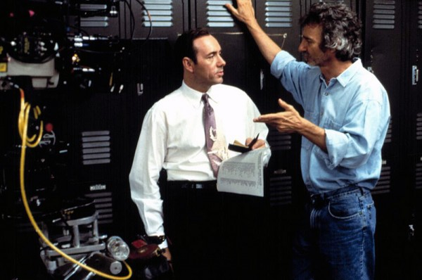 Curtis Hanson (Right) talks with Kevin Spacey (Center) on the set of LA Confidential